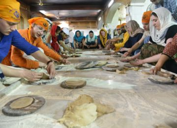 Making Rotis (Indian Bread) at Langar - A Sikh community kitchen at Gurudwara Bangla Sahib, Delhi