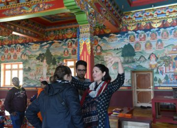 Prof of Religion talking to her students about the origins of Buddhism at Phyang Monastery, Leh, Jammu & Kashmir