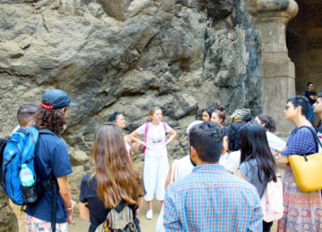 Guide talking about the rich history of Elephanta Caves, a UNESCO World Heritage Site which dates back to the 2nd century BCE