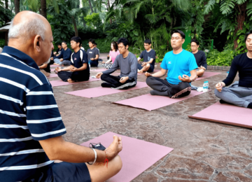 Early morning yoga and Indian Style Meditation session conducted at the open-air poolside of Hotel Leela.